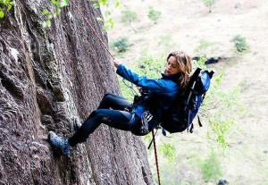 woman cliff repelling in a Lonely Place To Die movie