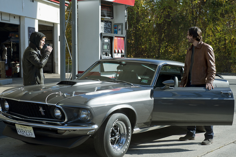 Alfie Allen and Keanu Reeves in John Wick movie talking at gas station about 1969 Mustang Mach 1
