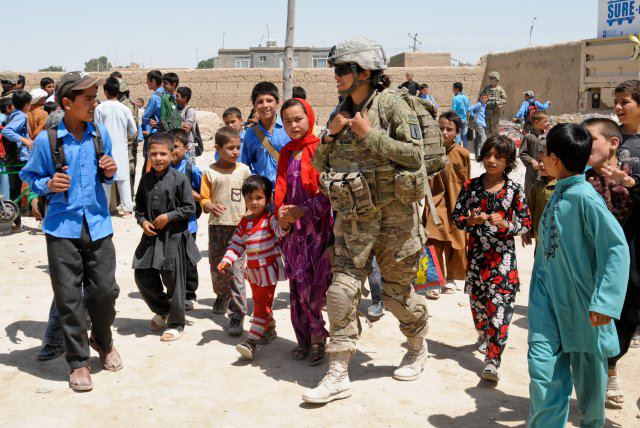 female soldier with children