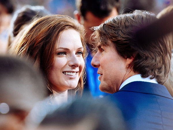 Rebecca Ferguson looks adoringly at Tom Cruise