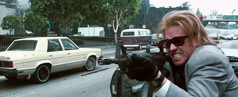Val Kilmer shooting in the streets in 1995's Heat