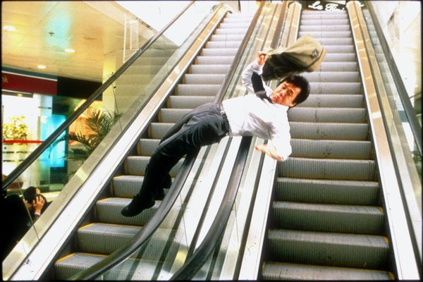 Jackie Chan in Chinese Zodiac sliding down an escalator railing