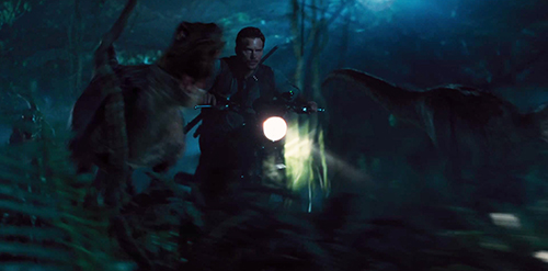 Chris Pratt as Owen in Jurassic World rides with the raptors
