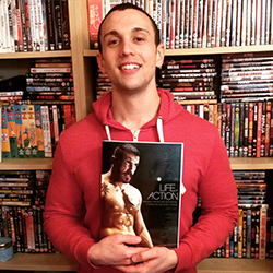 Mike Fury holding his book Life of Action