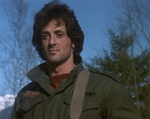 Sylvester Stallone as Rambo smiling in the opening of First Blood
