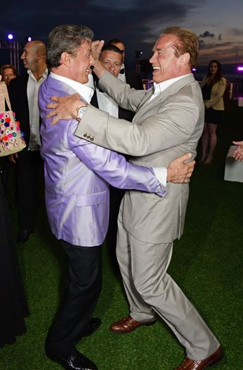 Sylvester Stallone dances with Arnold Schwarzenegger at the Cannes 2014 Expendables 3 party