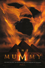 The Mummy movie poster showing the face of the mummy in sand above the pyramids in shadow
