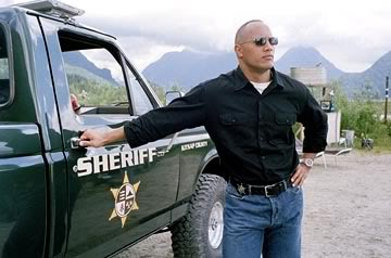 Dwayne Johnson as Sheriff Chris Vaughn with his green pick up truck from Walking Tall