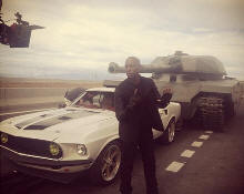 Tyrese Gibson with a tank and a Mustang from Fast & Furious 6
