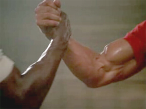 handshake/arm wrestling between Arnold Schwarzeneggar and Carl Weathers in PREDATOR