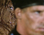 Greatest Action Movie moment ever Rambo: First Blood Part II wall of mud