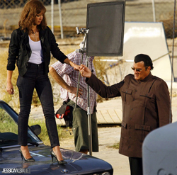 Steven Seagal helping Jessica Alba off the hood of a car in Machete
