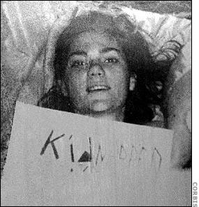 photograph of Barbara Jane Mackle with Kidnapped sign