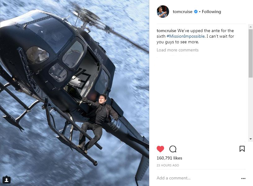 Tom Cruise's second photo on instagram, riding on the outside of a helicopter