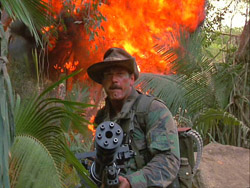 Predator movie Blain unleashes Ole Painless on the guerilla camp with a massive explosion behind him