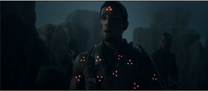 Adrien Brody as target in PREDATORS with multiple red dots