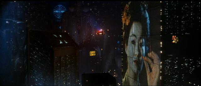 image of geisha on side of skyscraper in Blade Runner