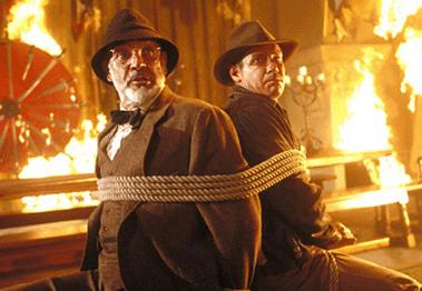 Sean Connery and Harrison Ford tied together in the fire scene in Indiana Jones and The Last Crusade