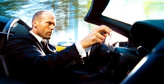 Jason Statham as The Transporter driving a car
