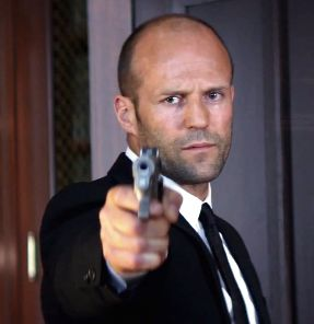 Jason Statham as Parker in the moment of ultimate retribution looking a little sad as he's about to shoot the head mobster