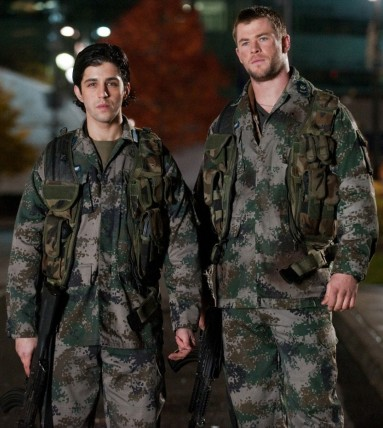 Josh Peck and Chris Hemsworth in fitigues in Red Dawn 2012