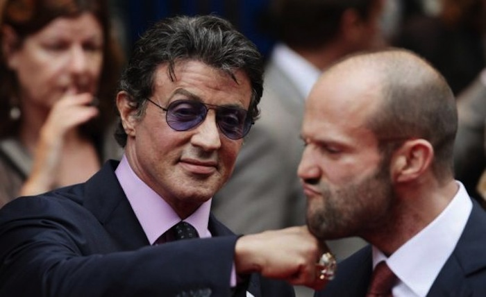 Sylvester Stallone play punching Jason Statham on the jaw