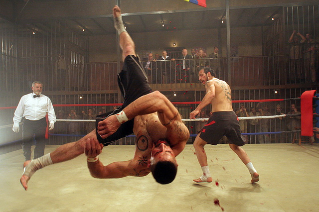 Scott Adkins as Yuri Boyka upside down, blood flying, in the ring in Undisputed III: Redemption fighting Marko Zaror as Raul 'Dolor' Quinones